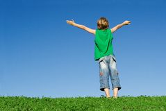 Happy child arms raised. Happy, healthy child arms raised with joy Stock Image