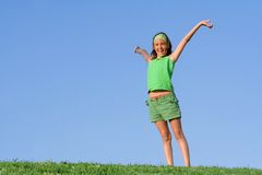 Happy child arms raised Royalty Free Stock Photos