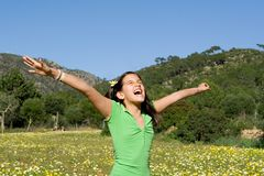 Happy child arms raised with joy Royalty Free Stock Photo