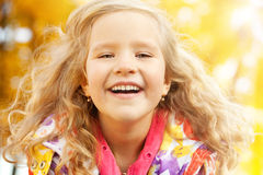 Happy child in autumn park Royalty Free Stock Photos