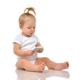 Happy child baby toddler sitting smiling and playing with mobile Stock Photos