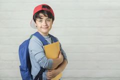 Happy child with backpack and with notebook,back to school stock image