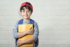 Happy child with backpack and with notebook,back to school stock photos