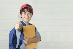 Happy child with backpack and with notebook,back to school royalty free stock photos