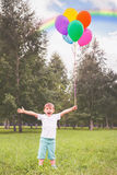 Happy child with balloons and beautiful rainbow outdoor Stock Photography