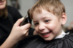 Happy child at the barbershop Stock Photo