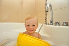Happy child bathes in a bathroom Royalty Free Stock Photos