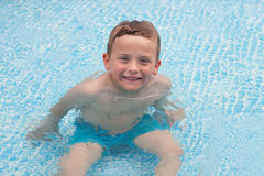 Happy child bathing in the pool Royalty Free Stock Photography