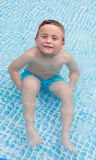 Happy child bathing in the pool Royalty Free Stock Photos