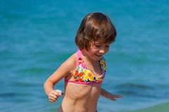 Happy child on the beach Stock Images