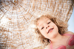 Happy child at the beach Stock Images