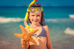 Happy child on the beach Stock Photos