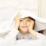 Happy child in the bed Stock Photography