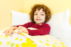 Happy child in bed Stock Photography