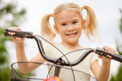 Happy child on a bicycle Royalty Free Stock Photos