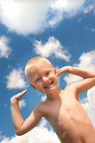Happy child and blue sky Royalty Free Stock Photography