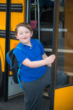 Happy child boarding school bus Royalty Free Stock Images