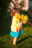 Happy child with bouquet of beautiful sunflowers. Sunny day, summer vacation. cute little girl with yellow sunflowers, outdoor portrait royalty free stock image