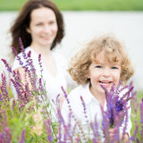 Mothers day. Happy child with bouquet of spring flowers outdoors. Mothers day concept Royalty Free Stock Photo