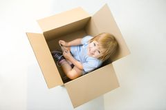 Happy child in box Stock Photos