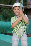 Happy child boy in adventure park Stock Photos