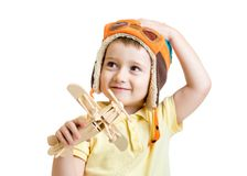 Happy child boy with airplane toy dreams to be Royalty Free Stock Image
