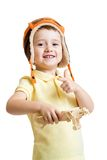 Happy child boy dressed pilot hat and playing with Stock Image