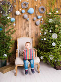 Happy child boy with gift box near Christmas tree. Happy boy with gift box near Christmas tree Royalty Free Stock Photos