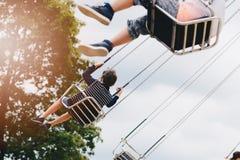 Happy child boy having fun in amusement park. Stock Photo