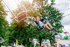 Happy child boy having fun in amusement park. Royalty Free Stock Images