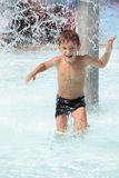 Happy child boy having fun in water. Young happy child boy having fun in water royalty free stock photos