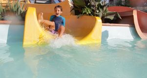 Happy child boy having fun in water park Stock Photo