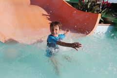 Happy child boy having fun in water park Royalty Free Stock Image
