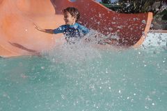 Happy child boy having fun in water park Royalty Free Stock Images