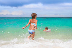 Happy child boy having fun in water, summer vacations on t Royalty Free Stock Photos