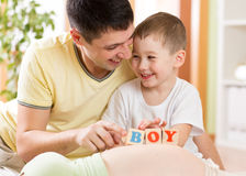 Happy child boy and his father play with toys on Stock Images