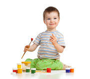 Happy child boy with paints over white background Royalty Free Stock Photos