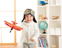Happy child boy play in airplane indoors Stock Photos