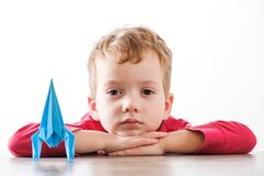 Happy boy playing with rocket. Happy child boy playing with handmade origami paper rocket Stock Photo