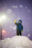 Happy Child Boy Playing During a Snowstorm Stock Image