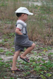 Happy child boy playing on the walk on summer field Stock Photos