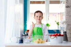 Happy child boy preparing a cake Stock Image