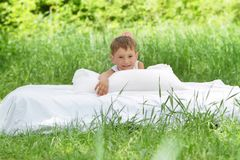 Happy child boy relaxing on nature Royalty Free Stock Image