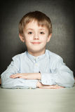 Happy child boy in school classroom Stock Photography