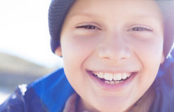 Happy child boy smile closeup. Outdoor backlight Royalty Free Stock Image