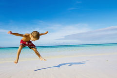 Happy child boy on tropical beach royalty free stock images
