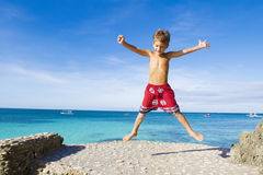 Happy child boy on tropical beach. Young happy child boy on tropical beach royalty free stock photo