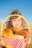 Happy child with bread in basket Stock Image