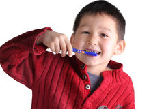 A child boy is brushing his teeth. With mouth open, eyes open, hands up Royalty Free Stock Images