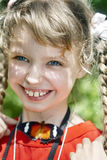 Happy child with butterfly on neck. Stock Photos